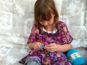 child crocheting