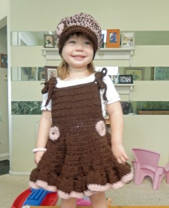Toddler jumper dress with matching newsboy style hat with heart accent.